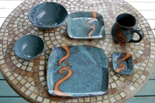 Six Piece Dinnerware Place Setting in Slate Blue with Rust Waves