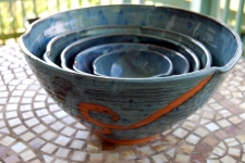 Set of Five Nesting Serving Bowls in Slate Blue and Rust Waves